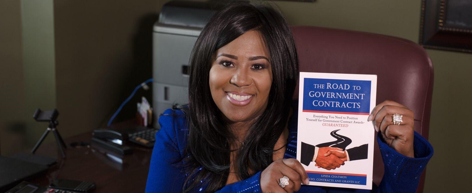 Linda Holding her book horizontal