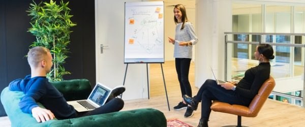 woman making presentation to two people